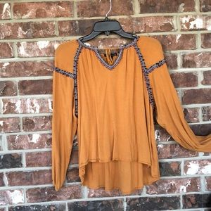 Mustard colored blouse with detail